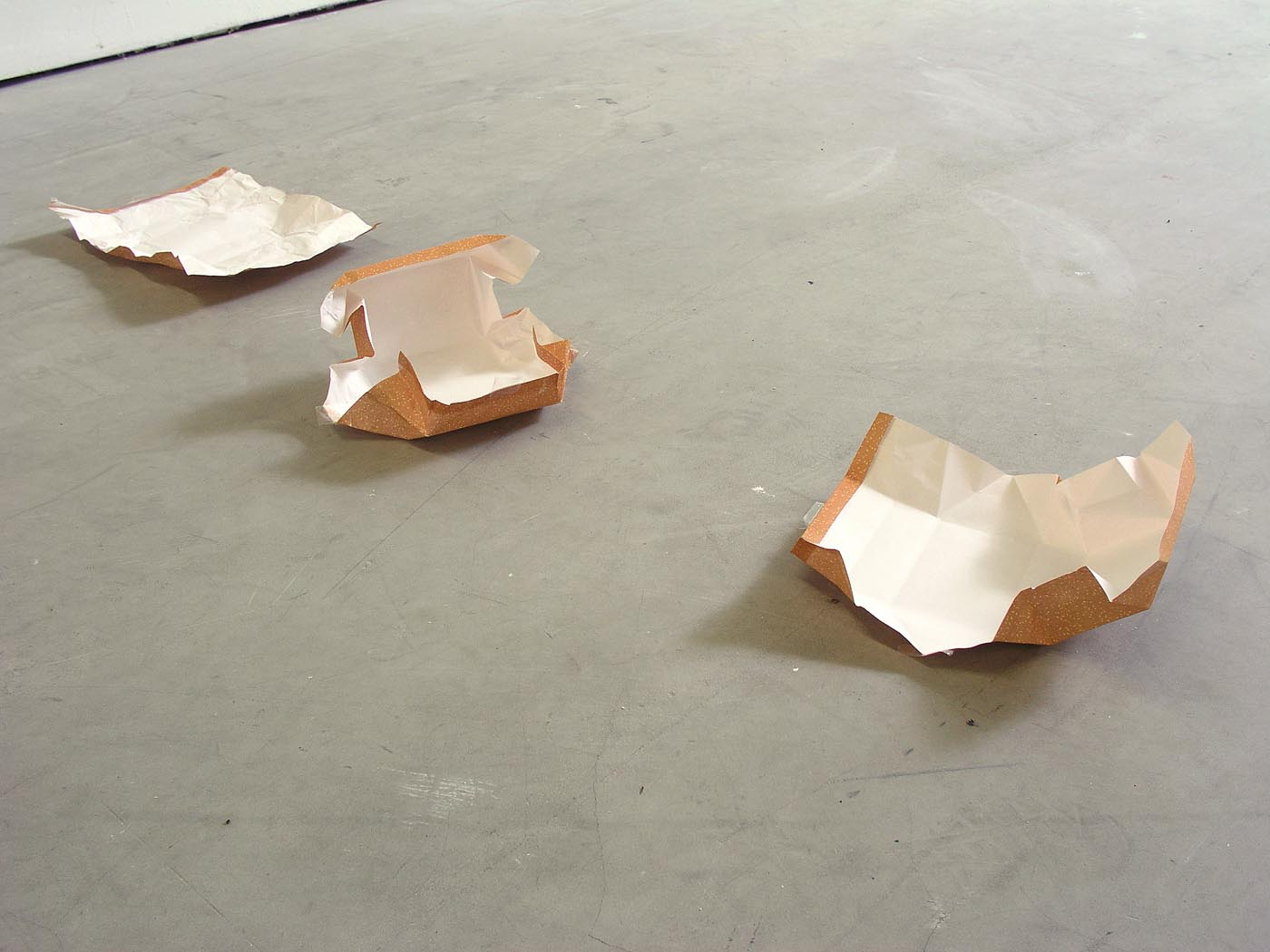 <i>gift</i>, 2007, an object wrapped once and unwrapped again, the same object wrapped eight times and unwrapped again, eight different objects each wrapped once and unwrapped again, 202 x 289 mm each, three sheets of gift wrapping paper, adhesive tape