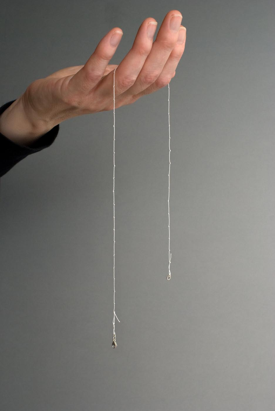 <i>Untitled (Scatter Piece)</i>, 2013, string of pearls without pearls